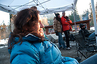 Deanna White listens to Stephen Vogler tell stories at an outdoor gathering during the 2010 Olympic Winter Games in Whistler, BC
