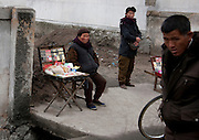 NORTH KOREA:<br /> The pictures Kim Jong Un doesn't want you to see<br /> <br /> Since 2008, Eric Lafforgue ventured to North Korea six times. Thanks to digital memory cards, I was able to save photos that I was forbidden to take or was told to delete by the minders.<br /> <br /> Photo Shows:  Street Seller, North Korea<br /> ©Eric Lafforgue/Exclusivepix Media