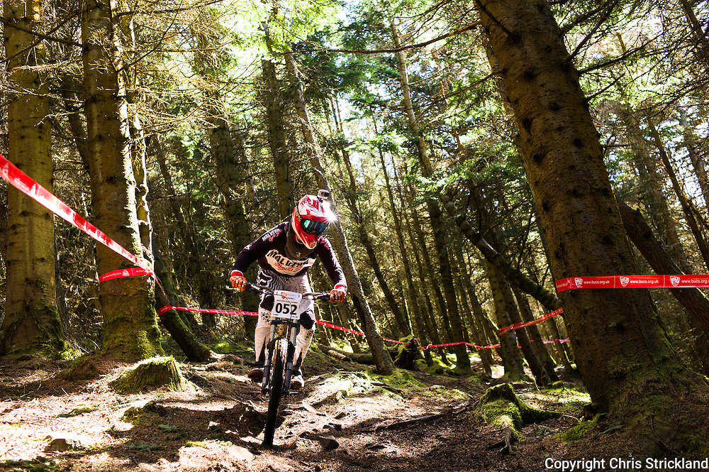 Innerleithen, Scottish Borders, UK. 18th April 2015. Todd Farr of the University of Wales Trinity St David Swansea in action during practice runs at the British Universities & Colleges Sport, Downhill Mountain Biking competition.