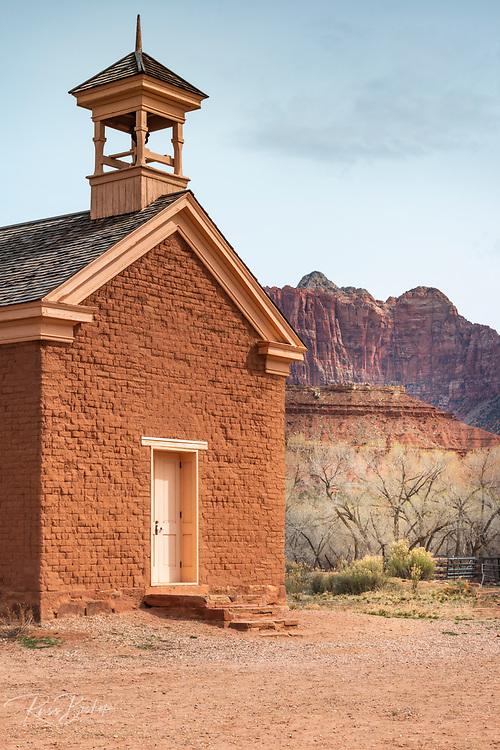 Adobe schoolhouse and Zion cliffs, Grafton ghost town, Utah USA