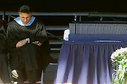 DEN09D:CLINTON-COLUMBINE:DENVER,22MAY99 - Columbine High School Principal Frank DeAngelis bows his head in thought next to the diplomas for graduating seniors of the school May 22 at the commencement ceremonies.  Two students of the CHS class of 1999 were killed in the May 20 shootings and three injured. rtw/Photo by Rick Wilking