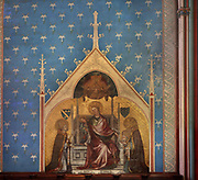 Virgin and child welcoming the soul of the bishop, with Saint Denis and Saint-Nicaise, 14th century fresco, restored in 19th century, in the Chapelle des Sept Douleurs, the 8th chapel of the ambulatory, in the Cathedrale Notre-Dame de Paris, or Notre-Dame cathedral, built 1163-1345 in French Gothic style, on the Ile de la Cite in the 4th arrondissement of Paris, France. The chapel was built from 1296 under Simon Matifas de Bucy, 83rd bishop of Paris 1298-1304. Photographed on 17th December 2018 by Manuel Cohen