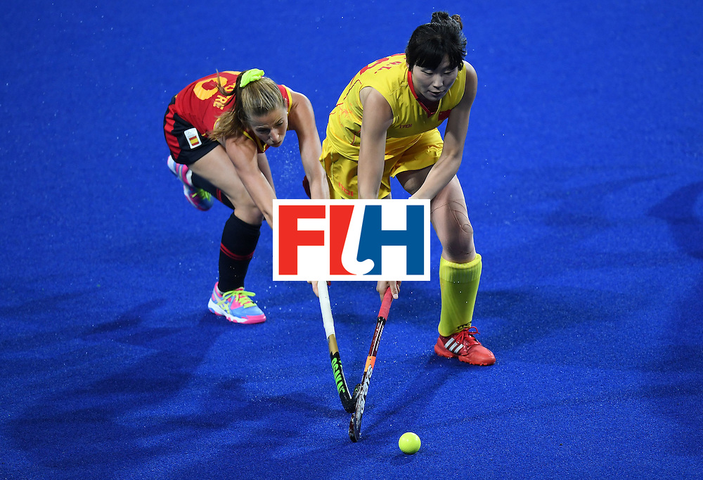 Spain's Berta Bonastre (L) and China's Song Qingling vie for the ball during the womens's field hockey Spain vs China match of the Rio 2016 Olympics Games at the Olympic Hockey Centre in Rio de Janeiro on August, 8 2016. / AFP / MANAN VATSYAYANA        (Photo credit should read MANAN VATSYAYANA/AFP/Getty Images)