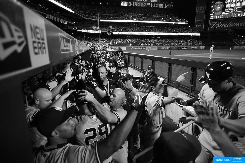 Dustin Ackley, New York Yankees, is congratulated by team mates in the dug out after hitting a three run homer in the sixth inning during the New York Mets Vs New York Yankees MLB regular season baseball game at Citi Field, Queens, New York. USA. 20th September 2015. Photo Tim Clayton