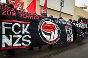 Frankfurt | 25 February 2017<br /> <br /> Am Samstag (25.02.2017) nahmen etwa 1000 Menschen in Frankfurt am Main an einer linksradikalen Demonstration unter dem Motto &quot;Make Racists Afraid Again&quot; Teil. Die Demo begann am S&uuml;dbahnhof in Frankfurt-Sachsenhausen und endete am Willy-Brandt-Platz. Organisiert wurde der Aufmarsch von dem B&uuml;ndnis &quot;Antifa United Frankfurt&quot;.<br /> Hier: Transparent mit einem Logo &quot;Antifaschistische Aktion&quot; und den Schriftz&uuml;gen &quot;FCK NZS&quot; und &quot;FCK AFD&quot;.<br /> <br /> photo &copy; peter-juelich.com