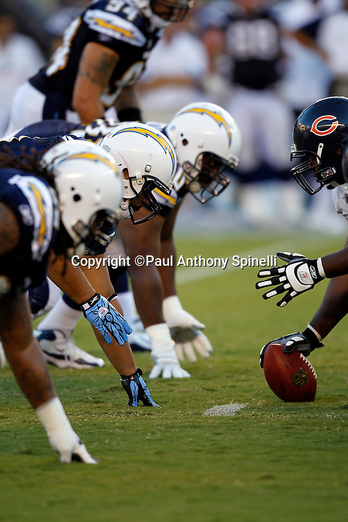 The San Diego Chargers defense gets set for the snap at the line of scrimmage during a NFL week 1 preseason football game against the Chicago Bears, Saturday, August 14, 2010 in San Diego, California. The Chargers won the game 25-10. (©Paul Anthony Spinelli)