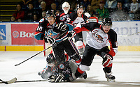 KELOWNA, CANADA, NOVEMBER 23: Filip Vasko #10 of the Kelowna Rockets is checked by Jesse Forsberg #6 of the Prince George Cougars as the Prince George Cougars visit the Kelowna Rockets  on November 23, 2011 at Prospera Place in Kelowna, British Columbia, Canada (Photo by Marissa Baecker/Shoot the Breeze) *** Local Caption *** Filip Vakso; Jesse Forsberg;