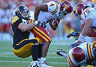 September 11 2010: Iowa Hawkeyes defensive tackle Dominic Alvis (79) pulls down Iowa State Cyclones quarterback Austen Arnaud (4) during the second half of the NCAA football game between the Iowa State Cyclones and the Iowa Hawkeyes at Kinnick Stadium in Iowa City, Iowa on Saturday September 11, 2010. Iowa defeated Iowa State 35-7.