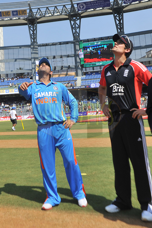 Alastair Cook of England and Mahendra Singh Dhoni captain of India  during the toss before the start of the 4th One Day International ( ODI ) match between India and England held at the Wankhede Stadium, Mumbai on the 23rd October 2011..Photo by Pal Pillai/BCCI/SPORTZPICS