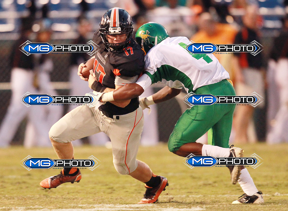 Hoover's Cooper Carden (17) is grabbed by