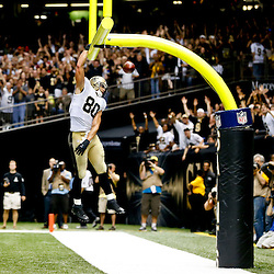 Sep 22, 2013; New Orleans, LA, USA; New Orleans Saints tight end Jimmy Graham (80) celebrates a touchdown against the Arizona Cardinals during a game at Mercedes-Benz Superdome. The Saints defeated the Cardinals 31-7. Mandatory Credit: Derick E. Hingle-USA TODAY Sports