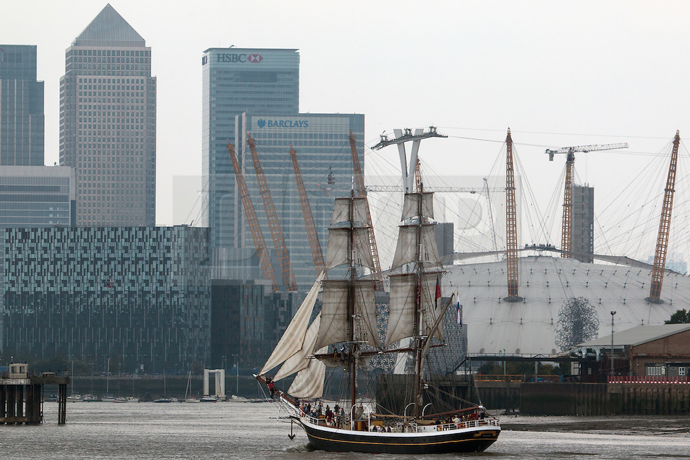 © Licensed to London News Pictures. 05/09/2014. The biggest tall ships on the Thames for a quarter of a century has got under way following a launch event under fireworks on the Thames. The regatta has brought 50 tall ships to London which are available to see across the weekend at Greenwich, Woolwich and Canary Wharf. Tall ship Morgenster arriving in London yesterday approaching the O2. Credit : Rob Powell/LNP