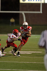 19 September 2009: Eyad Salem protects the ball as he gets wrapped up by Zac Burkhart in a game which the Austin Peay Governors were defeated 38-7 by the Illinois State Redbirds at Hancock Stadium on campus of Illinois State University in Normal Illinois