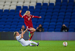 CARDIFF, WALES - Tuesday, August 21, 2014: Wales' Nadia Lawrence in action against England's Jordan Nobbs during the FIFA Women's World Cup Canada 2015 Qualifying Group 6 match at the Cardiff City Stadium. (Pic by David Rawcliffe/Propaganda)