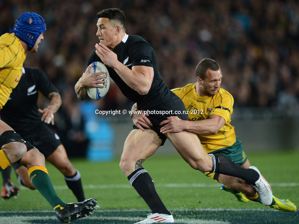 Sonny Bill Williams is tackled by Quade Cooper during the Rugby Championship and Bledisloe Cup Rugby Union test match, New Zealand All Blacks versus Australian Wallabies at Eden Park, Auckland, New Zealand. Saturday 25 August 2012.  Photo: Andrew Cornaga/Photosport.co.nz