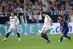 03-03-2007 VOETBAL: SEVILLA FC - BARCELONA: SEVILLA  <br /> Sevilla wint de topper met Barcelona met 2-1 / Jose Luis Marti Soler en Xavi - boarding unibet.com<br /> &copy;2006-WWW.FOTOHOOGENDOORN.NL