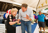 Hope Makris shares a moment with Governor Chris Sununu during the 96th cake cutting celebration at the Naswa Beach Bar Wednesday evening.  (Karen Bobotas/for the Laconia Daily Sun)