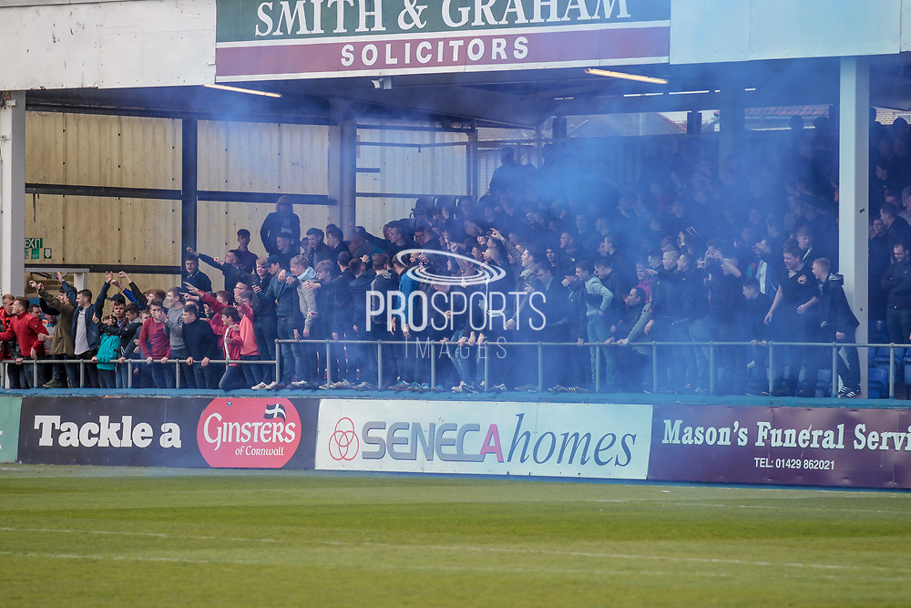 Carlisle United fans let off a smoke bomb before the EFL Sky Bet League 2 match between Hartlepool United and Carlisle United at Victoria Park, Hartlepool, England on 14 April 2017. Photo by Mark P Doherty.