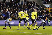 Millwall defender Mahlon Romeo (12) puts a shot through the legs of Blackburn Rovers defender Amari'i Bell (17) during the EFL Sky Bet Championship match between Millwall and Blackburn Rovers at The Den, London, England on 12 January 2019.