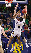 SOUTH BEND, IN - JANUARY 12: D.J. Harvey #5 of the Notre Dame Fighting Irish shoots the ball against Nik Popovic #21 of the Boston College Eagles at Purcell Pavilion on January 12, 2019 in South Bend, Indiana. (Photo by Michael Hickey/Getty Images) *** Local Caption *** D.J. Harvey; Nik Popovic