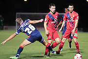York City midfielder James Barrett beats Doncaster Rovers midfielder James Coppinger  watched by York City midfielder, on loan from Oxford United, Michael Collins during the Johnstone's Paint Trophy match between York City and Doncaster Rovers at Bootham Crescent, York, England on 6 October 2015. Photo by Simon Davies.