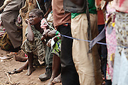 Displaced people wait in line to receive coupons at a non-food item fair at the Miketo IDP settlement, Katanga province, Democratic Republic of Congo on Sunday February 19, 2012. Displaced people who have lost most of their belongings as they fleed their homes receive coupons their can exchange for goods at a fair held in partnership with local traders.