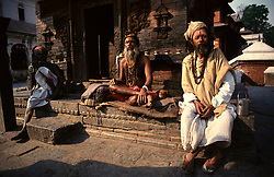 NEPAL KATHMANDU APR95 - Sadhus, devotees of Hindu god Shiva relax in the afternoon sun at Kathmandu's Pashupatinath temple compound. Nepal is the only Hindu kingdom in the world. <br />