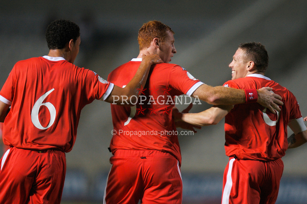 Nicosia, Cyprus - Saturday, October 13, 2007: Wales' goalscorer James Collins celebrates with team-mates Lewin Nyatanga and captain Craig Bellamy after opening the scoring against Cyprus during the Group D UEFA Euro 2008 Qualifying match at the New GSP Stadium in Nicosia. (Photo by David Rawcliffe/Propaganda)