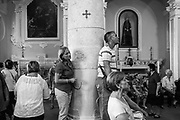 """26 August 2017, Guardia Sanframondi, Southern Italy - """"Riti Settennali di Penitenza"""" is a traditional penitential rite taking place in the southern Italian town of Guardia Sanframondi every seven years. Everything happens since centuries and it is the largest self-punishment rite in the Western world. A series of processions starts in the week following the Assumption. The """"Mysteries"""", honors the discovery of a Mary and Child statue in a field hundreds of years ago, through a series of parades of people dressed as characters from the Bible or recent religious episodes. The participants join together on the following Sunday for the main procession, when the flagellation occurs. More than thousand men and women dressed in white and wearing hoods to hide their face. Some participants, """"flagellanti"""", strike their backs with small strips of metal chained together. Others, """"battenti"""" tap against their bare chests with disks of cork pierced by needles, creating red patches of raw flesh, and sometimes blood. Attendants pour white wine on the cork as disinfectant, and to keep the wounds open. All this for for reconcile their sin with God. This year about a thousand people between """"battenti"""" and """"flagellanti"""" participated to the final procession on Sunday, the most striking and crowded. Many of these, (over the forty percent) they were women.The ritual has drawn some criticism over the years. The Italian journalist and writer Roberto Saviano, said that members of the local crime organization, the Camorra, use the anonymity as a way of seeking secret redemption. The next one will be in 2024."""