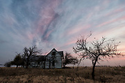 An old farmhouse beneath brilliant Oklahoma skies.