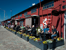 Cafes and restaurants in the summer by harbour at Lilla Bommen in Gothenburg Sweden
