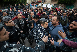 ©2020 Tom Nicholson. 11/01/2020. Beirut, Lebanon. Police scuffle with anti-government demonstrators, outside 'Electricité du Liban', the main Lebanese electricity provider. Demonstrators are taking part in a protest march from Daoura in east Beirut to Parliament in Downtown Beirut. The demonstrations are part of a wider movement which started in mid October 2019, campaigning against government corruption and economic crisis. Photo credit : Tom Nicholson