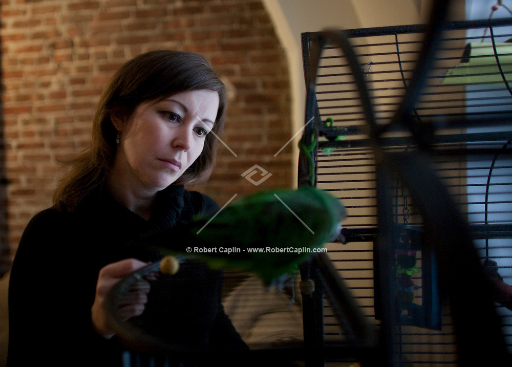 Tonia Misvaer with her birds Swami and Odin in her Upper West Side Apartment.