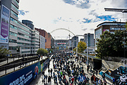 Fans stream down Wembley way from Wembley Park Tube Station during the International Series match between Jacksonville Jaguars and Philadelphia Eagles at Wembley Stadium, London, England on 28 October 2018.