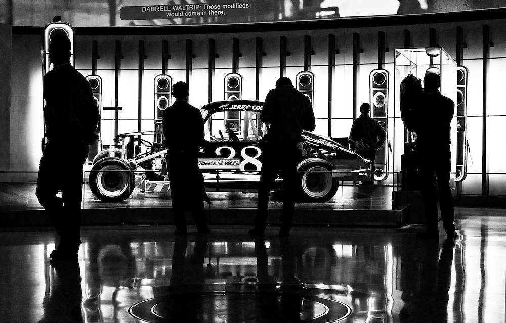 Silhouettes of visitors at the Nascar Museum in Charlotte, North Carolina