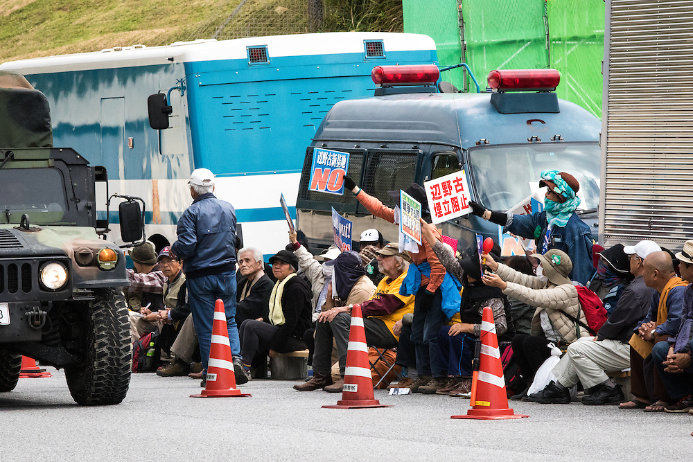OKINAWA, JAPAN - FEBRUARY 8 : Anti-US base protesters with placards stage a rally outside the Camp Schwab to protest against the construction of the new U.S Marine base on Feb. 8, 2017 in Nago, Okinawa prefecture, Japan. Japan's government started offshore construction work Monday on relocating a U.S. Marine base in Okinawa. (Photo by Richard Atrero de Guzman/NURPhoto)