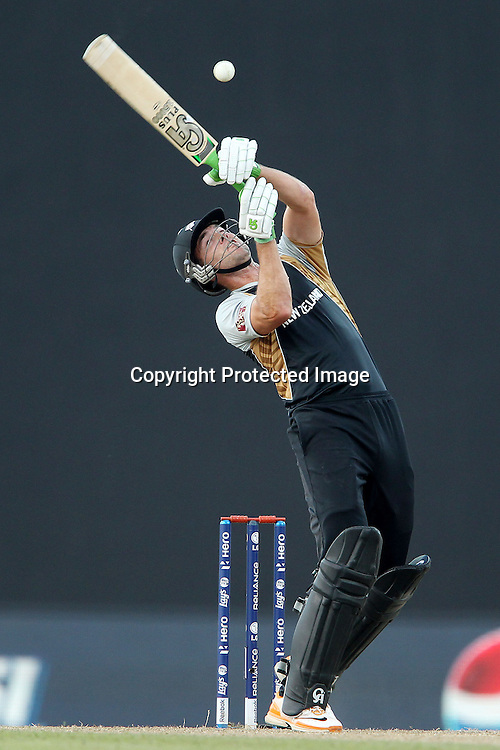James Franklin deals with a high delivery from Stuart Broad (Captain) of England  during the ICC World Twenty20 Super 8s match between England and New Zealand held at the  Pallekele Stadium in Kandy, Sri Lanka on the 29th September 2012<br /> <br /> Photo byRon Gaunt/SPORTZPICS/PHOTOSPORT