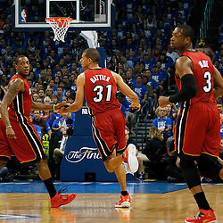 Jun 12, 2012; Oklahoma City, OK, USA;  Miami Heat point guard Mario Chalmers (15) congratulates Miami Heat small forward Shane Battier (31) against the Oklahoma City Thunder during the first quarter of game one in the 2012 NBA Finals at the Chesapeake Energy Arena.  Mandatory Credit: Derick E. Hingle-US PRESSWIRE