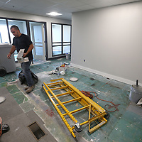 A painter walks through one of the office areas on the fifht floor thats being renovated at the BancorpSouth building in downtown Tupelo.