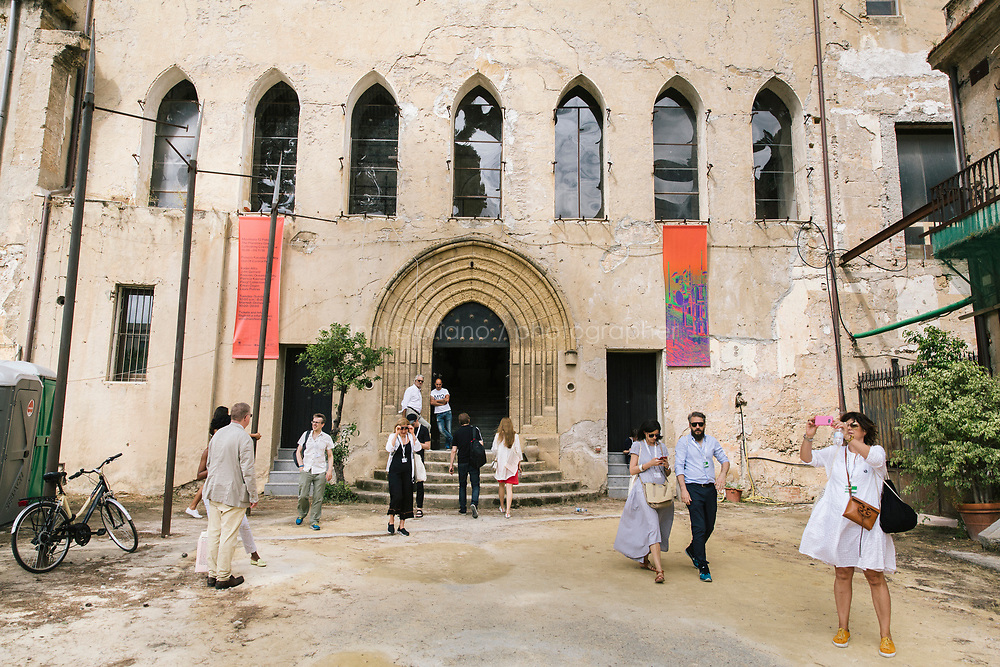 PALERMO, ITALY - 15 JUNE 2018: Visitors are seen here at the entrance fo Palazzo Forcella De Seta, a venue of Manifesta 12, the European nomadic art biennal, in Palermo, Italy, on June 15th 2018.<br /> <br /> Manifesta is the European Nomadic Biennial, held in a different host city every two years. It is a major international art event, attracting visitors from all over the world. Manifesta was founded in Amsterdam in the early 1990s as a European biennial of contemporary art striving to enhance artistic and cultural exchanges after the end of Cold War. In the next decade, Manifesta will focus on evolving from an art exhibition into an interdisciplinary platform for social change, introducing holistic urban research and legacy-oriented programming as the core of its model.<br /> Manifesta is still run by its original founder, Dutch historian Hedwig Fijen, and managed by a permanent team of international specialists.<br /> <br /> The City of Palermo was important for Manifesta&rsquo;s selection board for its representation of two important themes that identify contemporary Europe: migration and climate change and how these issues impact our cities.