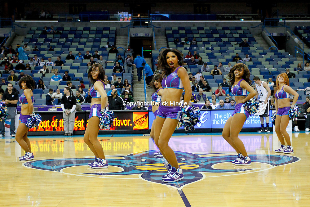 December 17, 2011; New Orleans, LA, USA; New Orleans Hornets Honeybees dancers perform following a team scrimmage at the New Orleans Arena.   Mandatory Credit: Derick E. Hingle-US PRESSWIRE