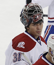 Dec 16, 2009; Newark, NJ, USA; Montreal Canadiens goalie Carey Price (31) relaxes at the bench during the third period of their game against the New Jersey Devils at the Prudential Center. The Devils won 2-1.