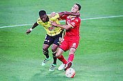 Phoenix' Roly Bonevacia keeps the ball from Adelaide United's Marcelo Carrusca during the Round 22 A-League football match - Wellington Phoenix V Adelaide United at Westpac Stadium, Wellington. Saturday 5th March 2016. Copyright Photo.: Grant Down / www.photosport.nz