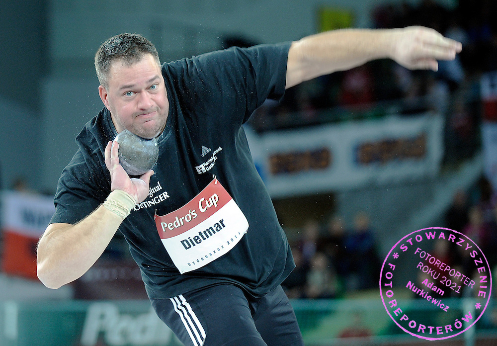 ANDY DIETMAR (GERMANY) COMPETES IN MEN'S SHOT PUT COMPETITION DURING INDOOR ATHLETICS MEETING PEDRO'S CUP 2011 IN LUCZNICZKA HALL IN BYDGOSZCZ...POLAND , BYDGOSZCZ , FEBRUARY 16, 2011..( PHOTO BY ADAM NURKIEWICZ / MEDIASPORT )..PICTURE ALSO AVAIBLE IN RAW OR TIFF FORMAT ON SPECIAL REQUEST.