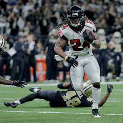 Dec 24, 2017; New Orleans, LA, USA; Atlanta Falcons running back Devonta Freeman (24) runs against the New Orleans Saints during the third quarter at the Mercedes-Benz Superdome. The Saints defeated the Falcons 23-13. Mandatory Credit: Derick E. Hingle-USA TODAY Sports