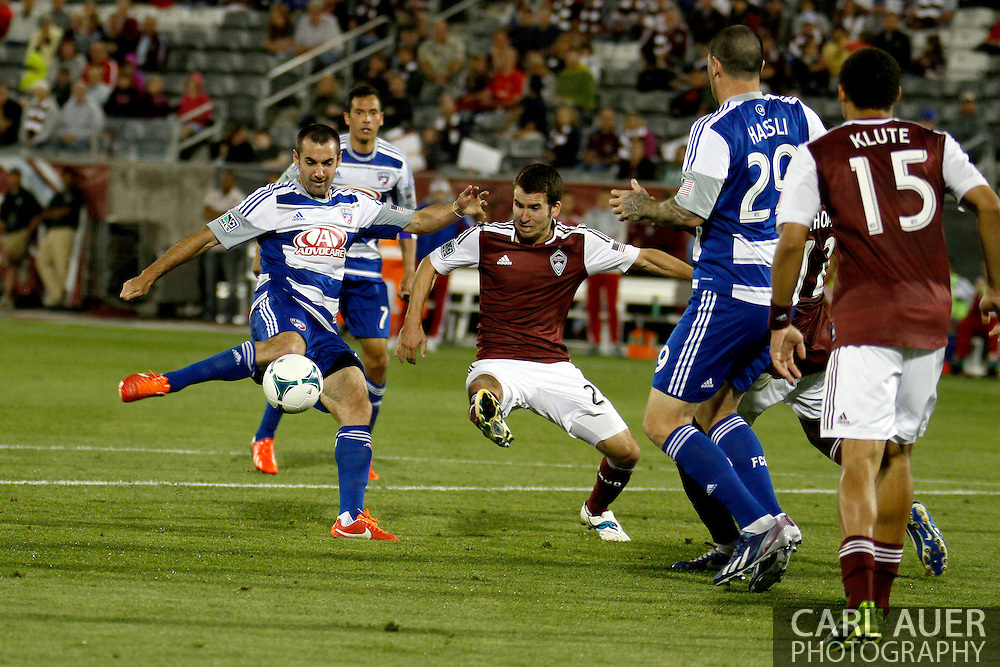 June 1st, 2013 - Colorado Rapids midfielder Nathan Sturgis (24) attempts to break up a shot on goal by FC Dallas midfielder Andrew Jacobson (4) in the second half of action in the MLS match between FC Dallas and the Colorado Rapids at Dick's Sporting Goods Park in Commerce City, CO