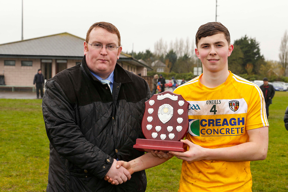 Leinster Minor Hurling - Shield Final at St Feckins GFC, 2nd April 2016<br /> Antrim vs Kildare<br /> Declan Byrne (Leinster Council Louth Representative) presents the Leinster Minor Hurling Shield to Antrim captain, Conor Carson after they defeated Kildare in the final<br /> Photo: David Mullen /www.cyberimages.net / 2016