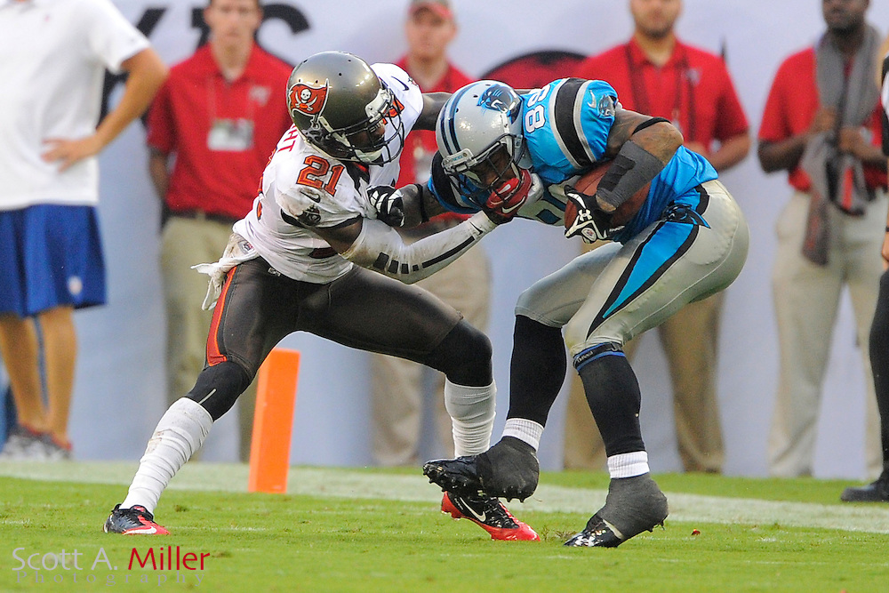 Tampa Bay Buccaneers defensive back Eric Wright (21) tackles Carolina Panthers wide receiver Steve Smith (89) during the Bucs 16-10 win at Raymond James Stadium  on September 9, 2012 in Tampa, Florida. ..©2012 Scott A. Miller...