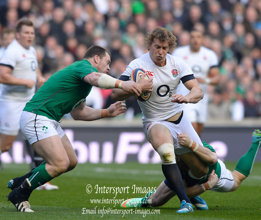 Twickenham Great Britain.  Englands, Billy TWELVETREES, running with the ball, left, Cian HEALY and low Brian O'DRISCOLL, tackle during the 2014 RBS Six Nations Rugby; England vs Ireland. Saturday  22/02/2014  [Mandatory Credit; Peter Spurrier/Intersport-images]