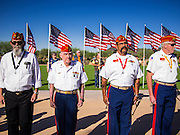 08 OCTOBER 2013 - PHOENIX, AZ: US military veterans stand at attention at a ceremony interring the cremated remains of unclaimed US military veterans at the National Memorial Cemetery in Phoenix. The cremated remains of 36 unclaimed US military veterans were interred at the National Memorial Cemetery in Phoenix. Members of the US military and several hundred veterans of the US military attended the service, which was a part of the Missing In America Project (MIAP).      PHOTO BY JACK KURTZ
